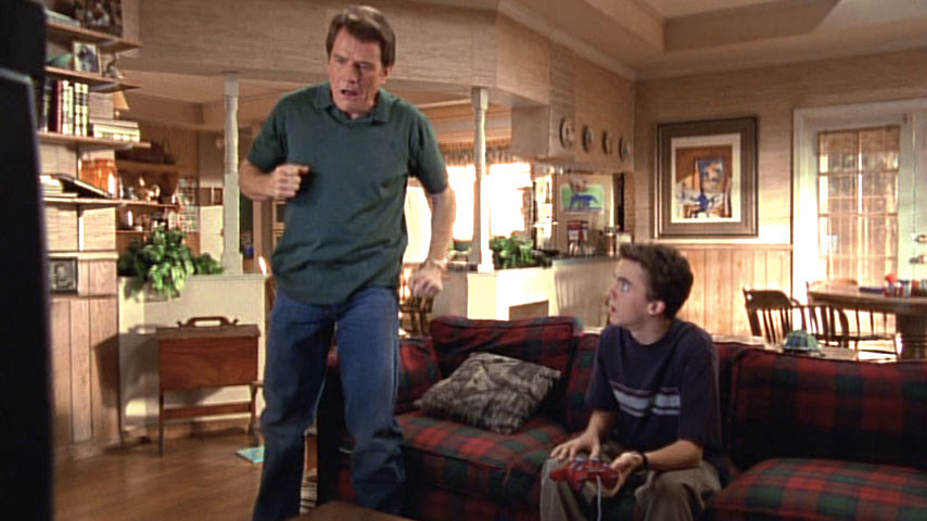Bryan Cranston (Hal) et Frankie Muniz (Malcolm) dans